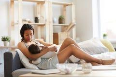 Black mom breastfeeding baby