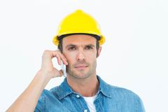 Serious carpenter using mobile phone Royalty Free Stock Image