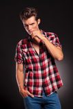 Serious casual young man posing. And looking at camera  on dark background Royalty Free Stock Photography