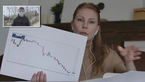 Serious Caucasian blond woman showing graphs as man in face mask agreeing with CEO in online chat. Business people