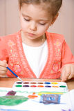 Serious caucasian child watercolor paint Royalty Free Stock Photos