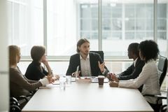 Serious ceo leading corporate team meeting talking to multiracia. Serious ceo leading corporate team meeting talking to multi-ethnic employees giving royalty free stock photography