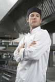 Serious Chef With Arms Crossed In Kitchen Royalty Free Stock Photography