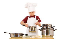 Serious chef checking the food Royalty Free Stock Photo