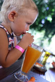 Serious child drinking fresh juice Royalty Free Stock Photography