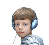 Serious child with earphones Stock Images