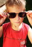 Serious child with glasses Royalty Free Stock Photos