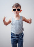 Serious child making symbols with fingers Royalty Free Stock Photo