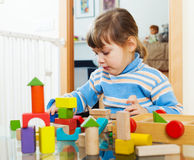 Serious child playing with toys Stock Photography