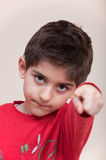 Serious child pointing Stock Image