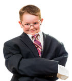 Serious child wearing suit that is too big Stock Photos