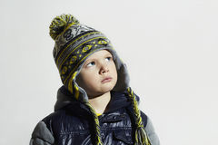 Serious child.winter fashion kids.fashionable little boy in cap Royalty Free Stock Photography