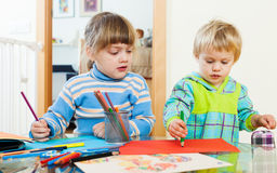Serious children sketching with paper and pencils Royalty Free Stock Photography