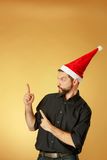 The serious christmas man wearing a santa hat Stock Photography