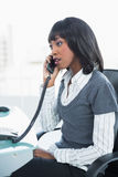Serious classy businesswoman talking on the phone Royalty Free Stock Image