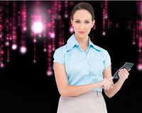 Serious classy businesswoman using calculator Royalty Free Stock Image