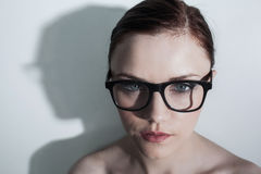Serious clean model with classy glasses posing Royalty Free Stock Image
