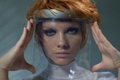 Serious clever woman in glass mask royalty free stock photography