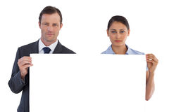 Serious co workers holding a blank copy space Stock Image