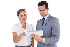 Serious co workers using a tablet pc Stock Photography