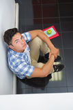 Serious college student sitting on the floor Stock Photography