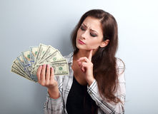Serious concentrated thinking business lady thinking where inves Royalty Free Stock Photo
