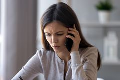 Free Serious Concerned Woman Talking On The Phone Helping Solving Problem Stock Photo - 138233170