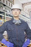 Serious and confident construction worker on site with hands on hips, portrait Royalty Free Stock Photos