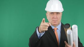 Serious and Confident Engineer Image Pointing with Finger stock photo