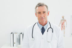 Serious confident male doctor at the medical office Royalty Free Stock Photography