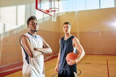 Confident successful leading basketball players on court stock images