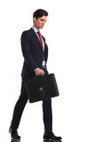 Serious and confident young business man is walking Stock Photo