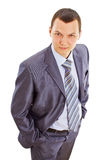 Serious confident young businessman in suit Stock Images