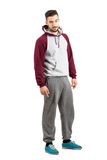 Serious confident young man in casual sportswear looking at camera Royalty Free Stock Photos