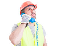 Serious constructor calling someone to solve work problem Royalty Free Stock Images