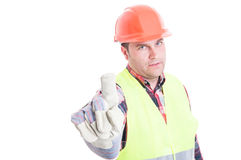 Serious constructor doing refusal gesture. Serious constructor doing refusal or rejection gesture with finger isolated on white background Royalty Free Stock Images