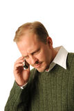 Serious Conversation. Young Professional Male Using Cell Phone Royalty Free Stock Images