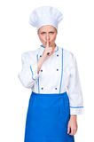 Serious cook holding finger on lips Royalty Free Stock Photography