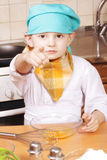 Serious cook pointing forefinger Royalty Free Stock Photo