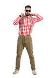 Serious cool bearded hipster adjusting suspenders Stock Photo