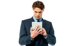 Serious corporate working on tablet pc Royalty Free Stock Image