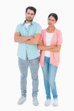 Serious couple with arms crossed Stock Photos