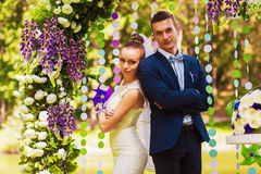 Serious couple in beautiful arch royalty free stock photo