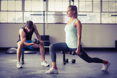 Serious couple exercising with dumbbells Stock Photo