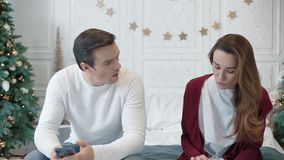 Serious couple looking mobile phones in luxury bedroom. stock footage