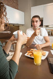 Serious couple with problems speak at breakfast Stock Image