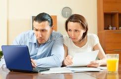 Serious couple  reading document Stock Photo