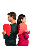 Serious couple standing back to back Royalty Free Stock Images