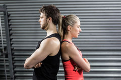 Serious couple standing back to back Stock Photos