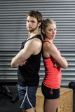 Serious couple standing back to back Stock Images